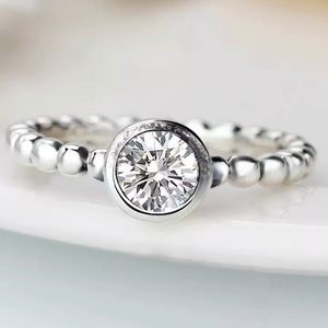 Round Bezel Set CZ on Sterling Silver Bead Band